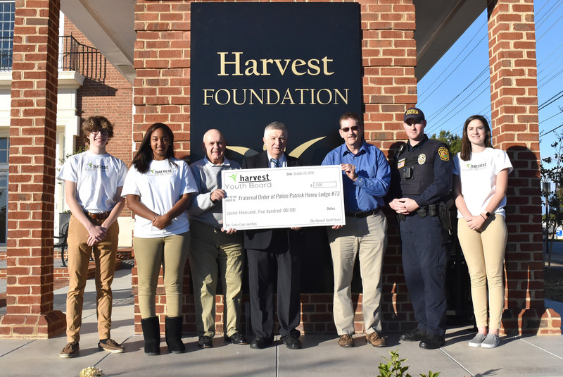 Harvest Youth Board makes $7,500 grant to Santa, Cops and Kids